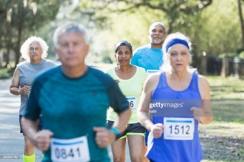Group of multi-ethnic seniors running a race : Stock Photo