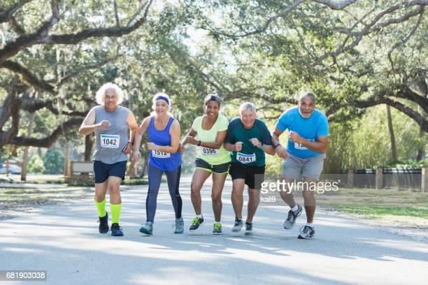 Group of multi-ethnic seniors running a race
