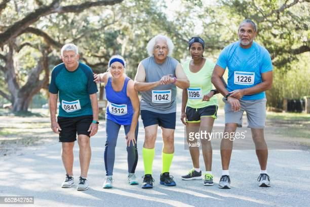 Group of multi-ethnic seniors set to run in a race