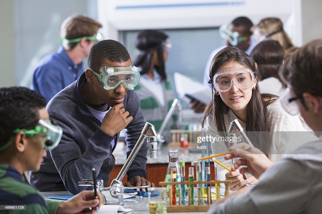 Group of multi-ethnic students in chemistry lab : Stock Photo