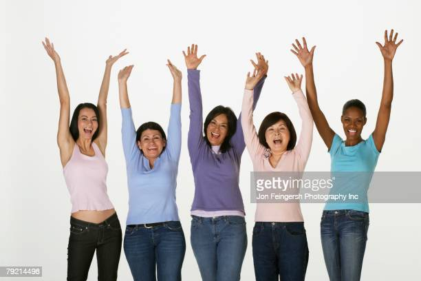 Group of multi-ethnic women cheering