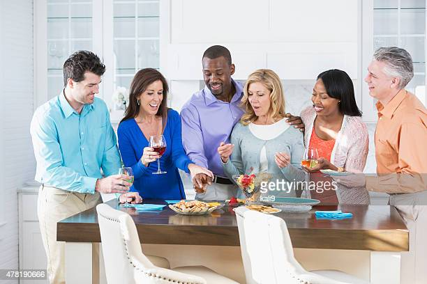 Group of multiracial adult friends having fun at a party