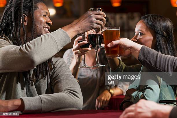 Group of multiracial friends drinking and toasting