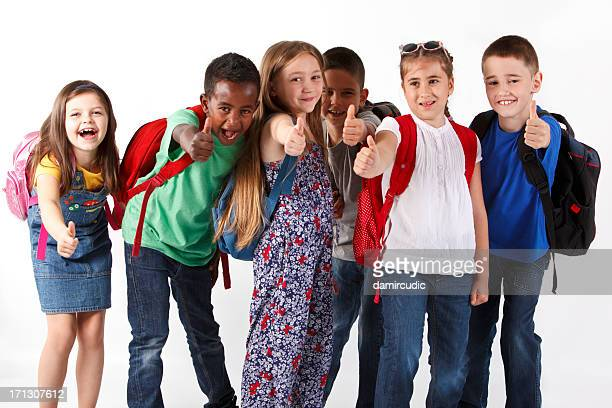 Group of multiracial school children shouting and showing thumbs-up