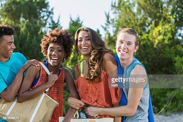 Group of multiracial young adults having fun in summer