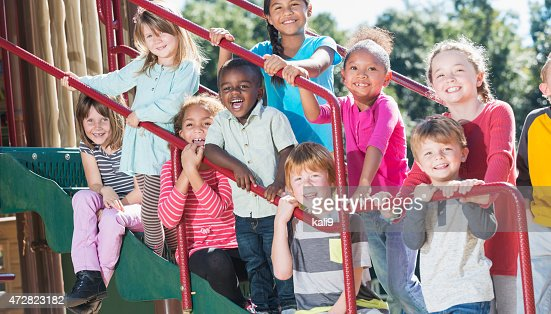 Group of multracial children on a playground