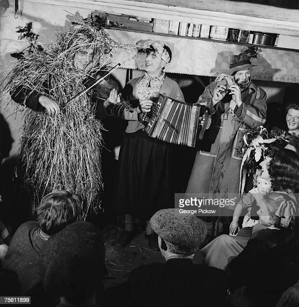 A group of mummers in Ireland celebrate St Stephen's Day or 'Wren's Day' on 26th December by processing from house to house with their instruments...