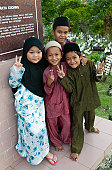 Group of Muslim children by Kuching Mosque.