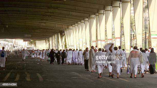 A group of Muslim pilgrims walk to visit Mount Arafat also called Jabal alRahmah as they take part in the hajj rituals in Mecca Saudi Arabia on...