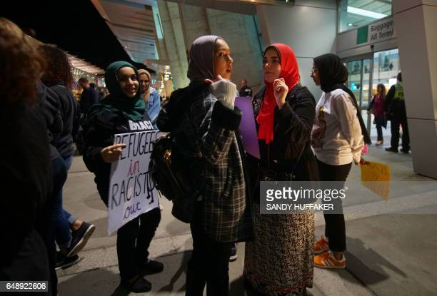A group of Muslim protesters confer during a rally against the travel ban at San Diego International Airport on March 6 2017 in San Diego California...