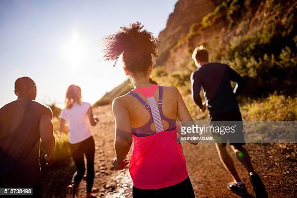 Group of mutli-ethnical athletes running outdoors
