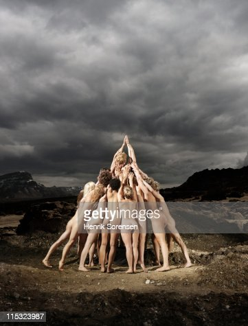 group of naked people forming a pyramid : Foto stock
