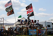 A group of NASCAR fans watches the action from the infield during the NASCAR Nationwide Zippo 200 at Watkins Glen International on August 9 2014 in...