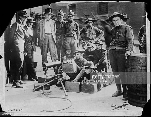 A group of National Guardsmen aim a Browning M1917 machine gun as other Guardsmen and men look on during race riots in Knoxville Tennessee September...