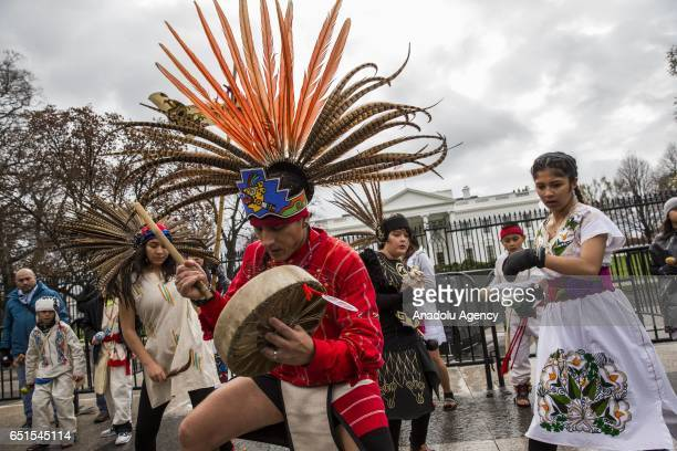 A group of Native Americans perform a traditional dance in front of the White House while protesting the construction of the Dakota Access Pipeline...