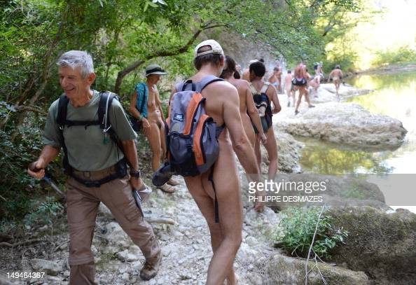 A group of naturist people take part in a hike along the Aiguillon riverbed on July 26 2012 near Lussan eastern France Tired of staying in nudist...
