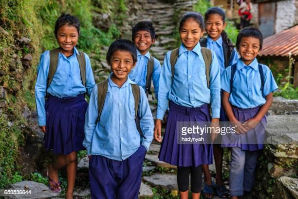 Group of Nepalese school children  in village near Annapurna Range