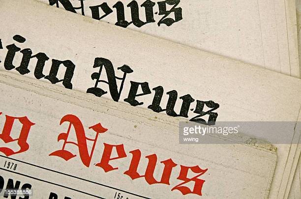Group of newspapers with old yellow pages