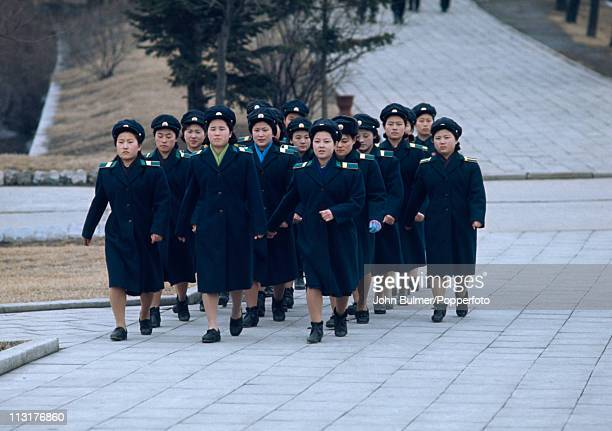 A group of North Korean women marching in uniform North Korea February 1973