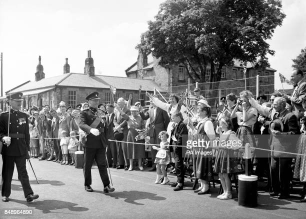 A group of Norwegians greet King Olav of Norway on a visit to Richmond in Yorkshire He is visiting the Green Howards Regiment of which he is...