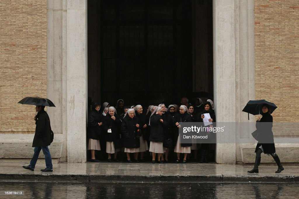 A group of nuns wait for a bus in heavy rain on March 13, 2013 in Vatican City, Vatican. Argentinian Cardinal Jorge Mario Bergoglio was later elected as the 266th Pontiff and will lead the world's 1.2 billion Catholics.