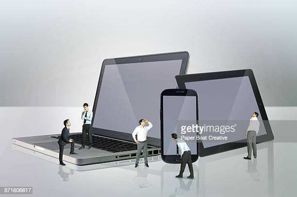 Group of office men standing by mobile devices