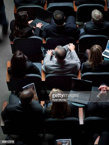 Group of office workers in auditorium, overhead