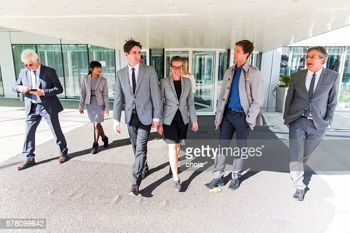 Group of ofiice worker comming from revolving door,going home