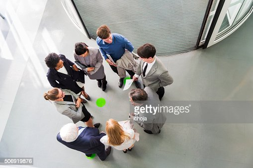 Group of ofiice worker standing in circle