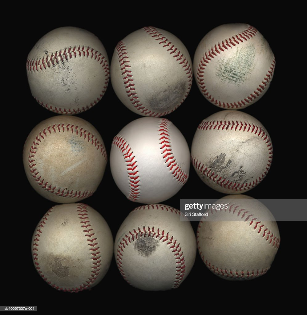 Group of old baseballs on black background : Stock Photo
