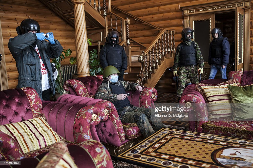 A group of opposition activists take over a mansion allegedly connected to former Ukrainian president Yanukovich's family and close circle February 24, 2014 in Koncha Zaspa area near Kiev, Ukraine. The group reportedly searched for documents incriminating Yanukovich in the financing of this extravagant housing compound. The Ukrainian interim interior minister has today announced that an arrest warrant has been issued for ousted President Viktor Yanukovych as the Ukrainian parliament moves forward with scheduling new elections and establishing a caretaker government.