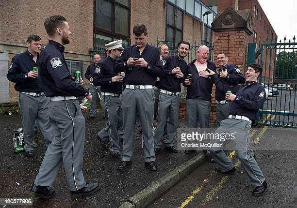 A group of Orange bandsmen joke with one another as they prepare for the start of the Twelfth of July parade on July 13 2015 in Belfast Northern...