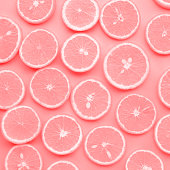 Group of orange slice in pink color.fruit and summer concept idea.flat lay design