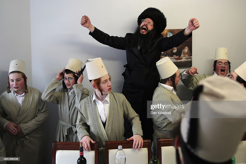 A group of Orthodox Jewish boys dance in the home of a local businessmen while collecting money for their school during the Jewish holiday of Purim...