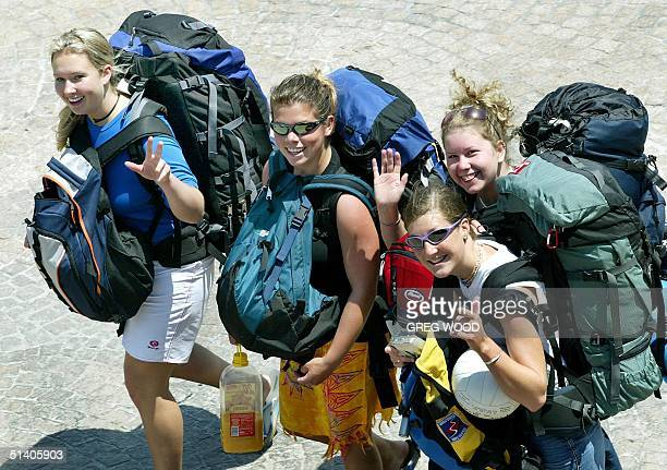 A group of overseas backpackers enjoy a walk through the popular tourist area of Circular Quay in Sydney 20 November 2002 Despite concerns over...
