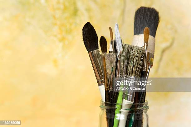 Group of paintbrushes in a glass