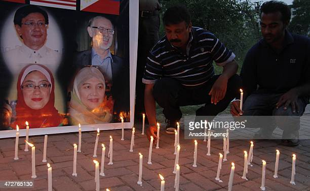 A group of Pakistanis attend a candle light vigil in Islamabad Pakistan on May 9 in memory of the victims of an army helicopter crash in the northern...