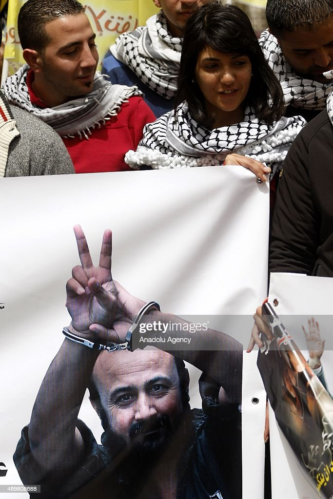 A group of Palestinian gather to hold a demonstration demanding the release of <a gi-track='captionPersonalityLinkClicked' href=/galleries/search?phrase=Marwan+Barghouti&family=editorial&specificpeople=243140 ng-click='$event.stopPropagation()'>Marwan Barghouti</a>, leader of the Palestinian group Fatah, prisoned in the Israeli jails, in Ramallah on April 15, 2015.