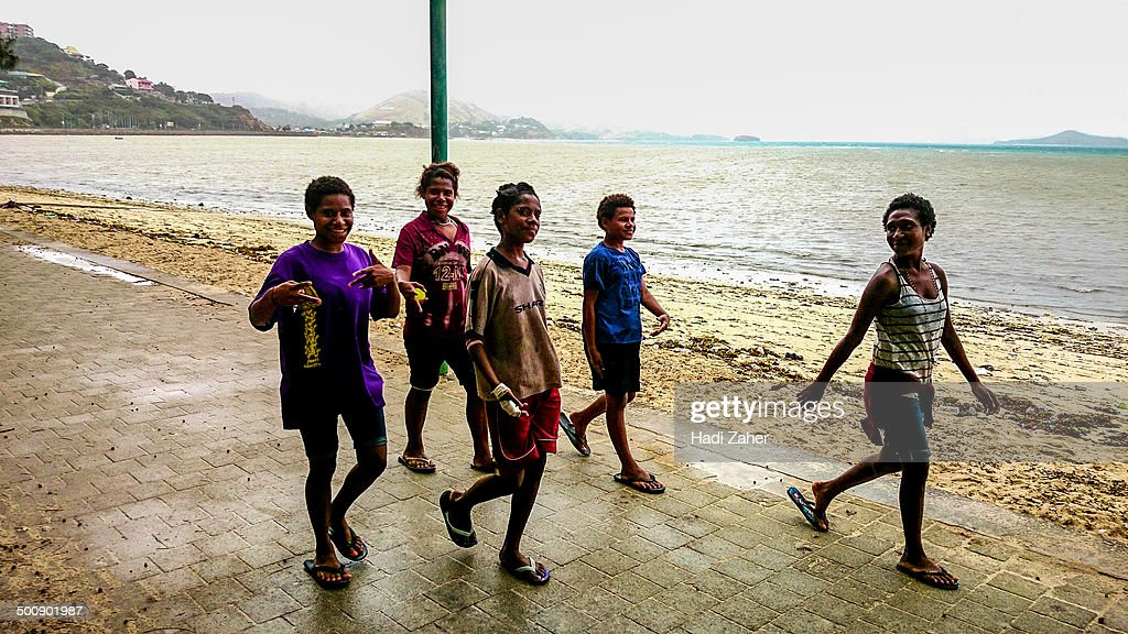 CONTENT] A group of Papuan girls walking on the beach in Port Moresby