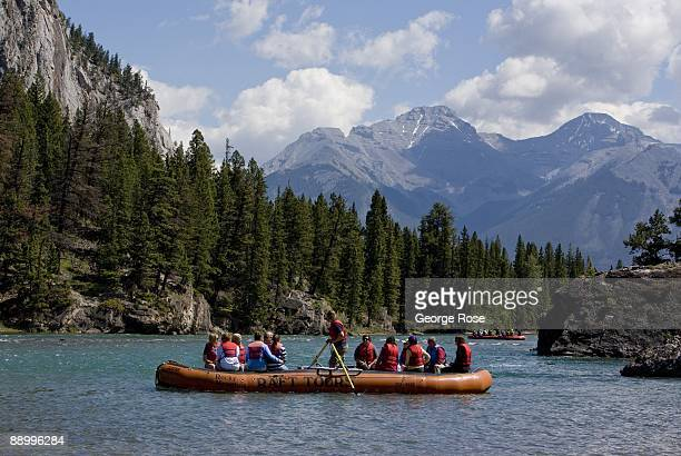A group of Park visitors float down the Bow River in an inflatable raft as seen in this 2009 Banff Springs Canada summer morning landscape photo