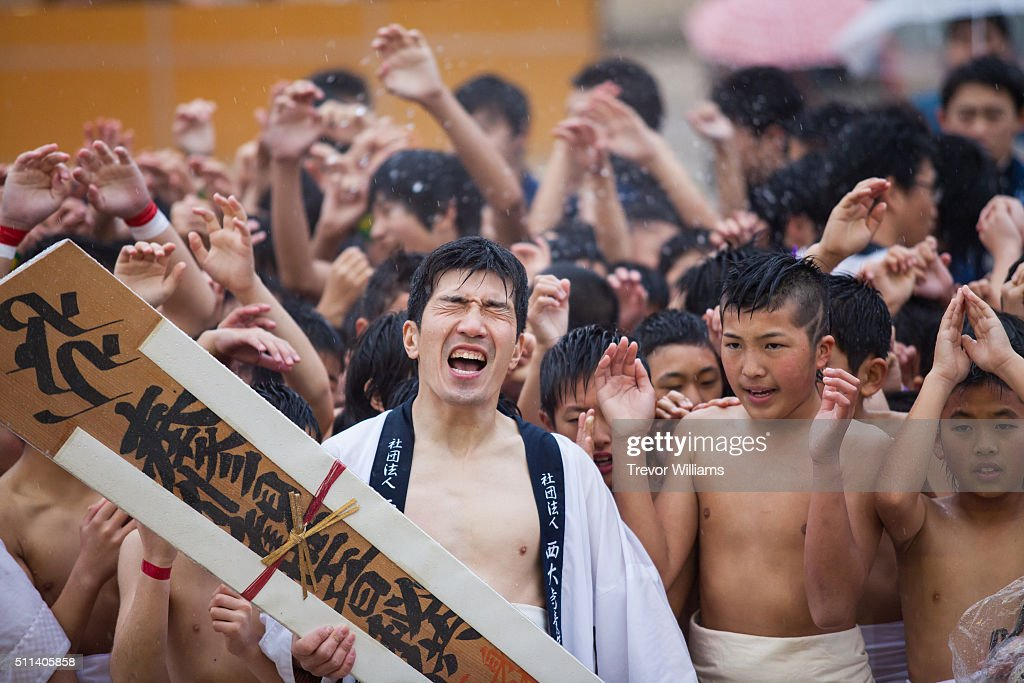 A group of participants arrive at the temple grounds at the Hadaka Matsuri or Naked Festival at Saidaiji Temple on February 20 2016 in Okayama Japan...