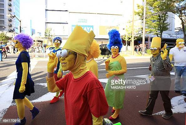 A group of participants dressed up as the characters from the Simpsons are seen during the Halloween parade on October 25 2015 in Kawasaki Japan...