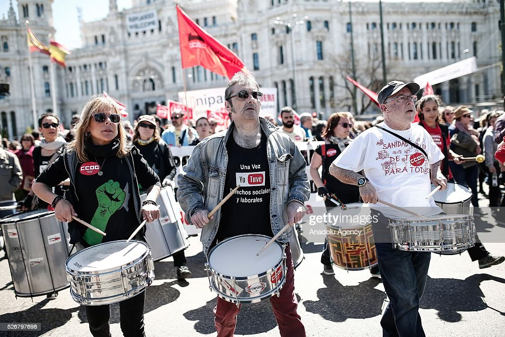 A group of participants play drums as workers, organized by labor unions and other labor organization take part in a rally to mark May Day, International Workers' Day in Madrid, Spain on May 01, 2016. Every year May Day is observed and commemorated as an official holiday all around Spain.