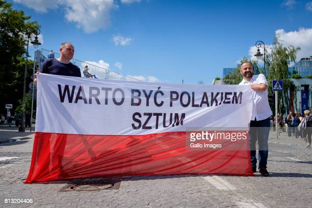 A group of peaceful protestors mostly women gathered to voice their disapproval of Donald Trump's visit and speech on July 06 2017 in Warsaw Poland...