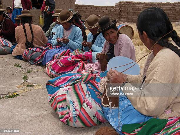 A group of peasant women knitting in the prairie Indigenous women from Juliaca in the Peruvian altiplano use to meet to weave traditional products to...