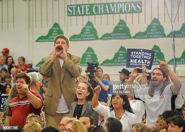 A group of people against health care reform shout until they are removed by police during a town hall meeting on 'Healthcare Reform Efforts'...