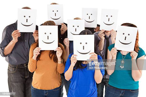 Group of People All Holding Smiley Faces