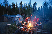 Group of people around campfire