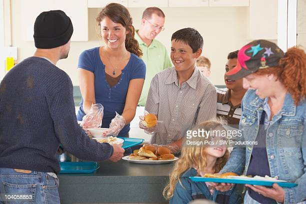 Group Of People At Community Buffet