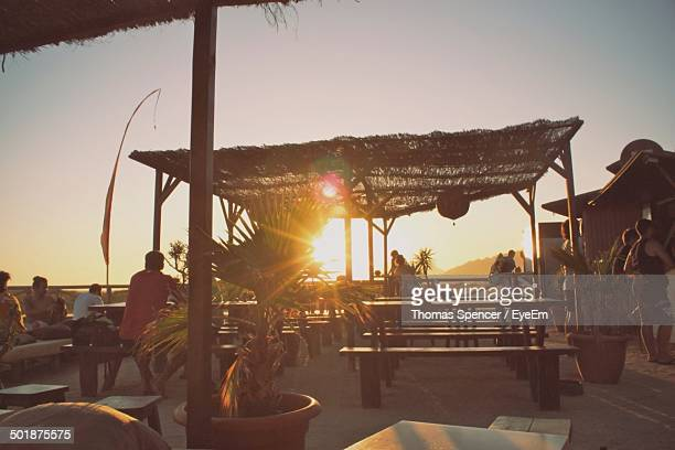 Group of people at outdoor restaurant at sunset